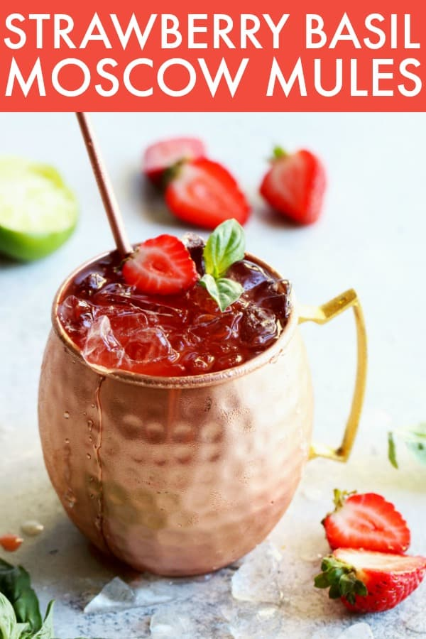 Hydrate this summer with these deliciously refreshing Strawberry Basil Moscow Mules! They're so simple to mix up and perfect for summertime sipping! thetoastedpinenut.com #thetoastedpinenut #moscowmules #cocktail #easycocktail #strawberry #moscowmule