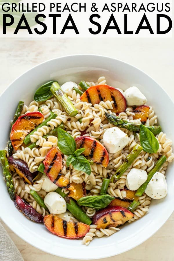 The perfect summer pasta salad is here! This Grilled Peach + Asparagus Pasta Salad is loaded with grilled peaches, asparagus, and a juicy lemony dressing! thetoastedpinenut.com #pastasalad #peaches #peachrecipe #grilledpeaches