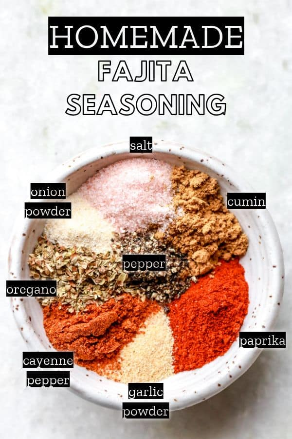 small bowl of fajita seasoning spices sectioned off in the bowl and labeled pinterest image
