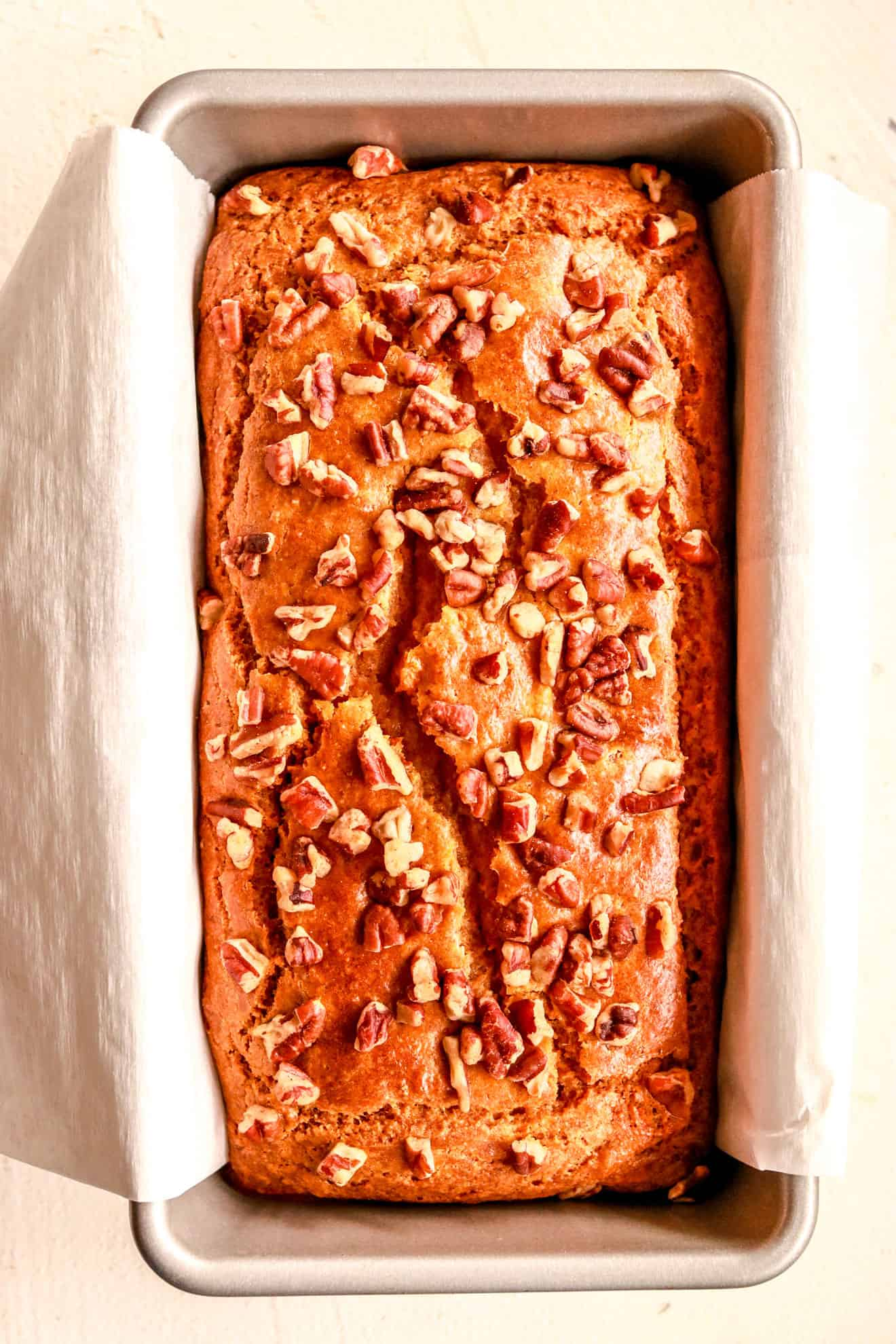 sweet potato bread in a load pan on white background