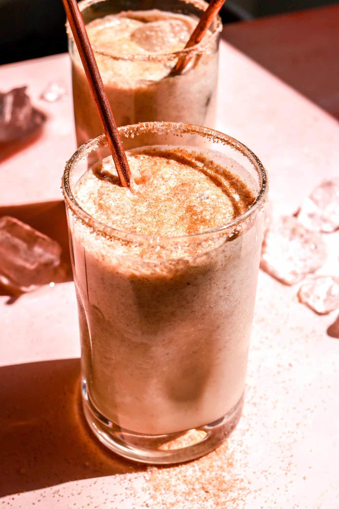 side view of ice horchata recipe on pink table