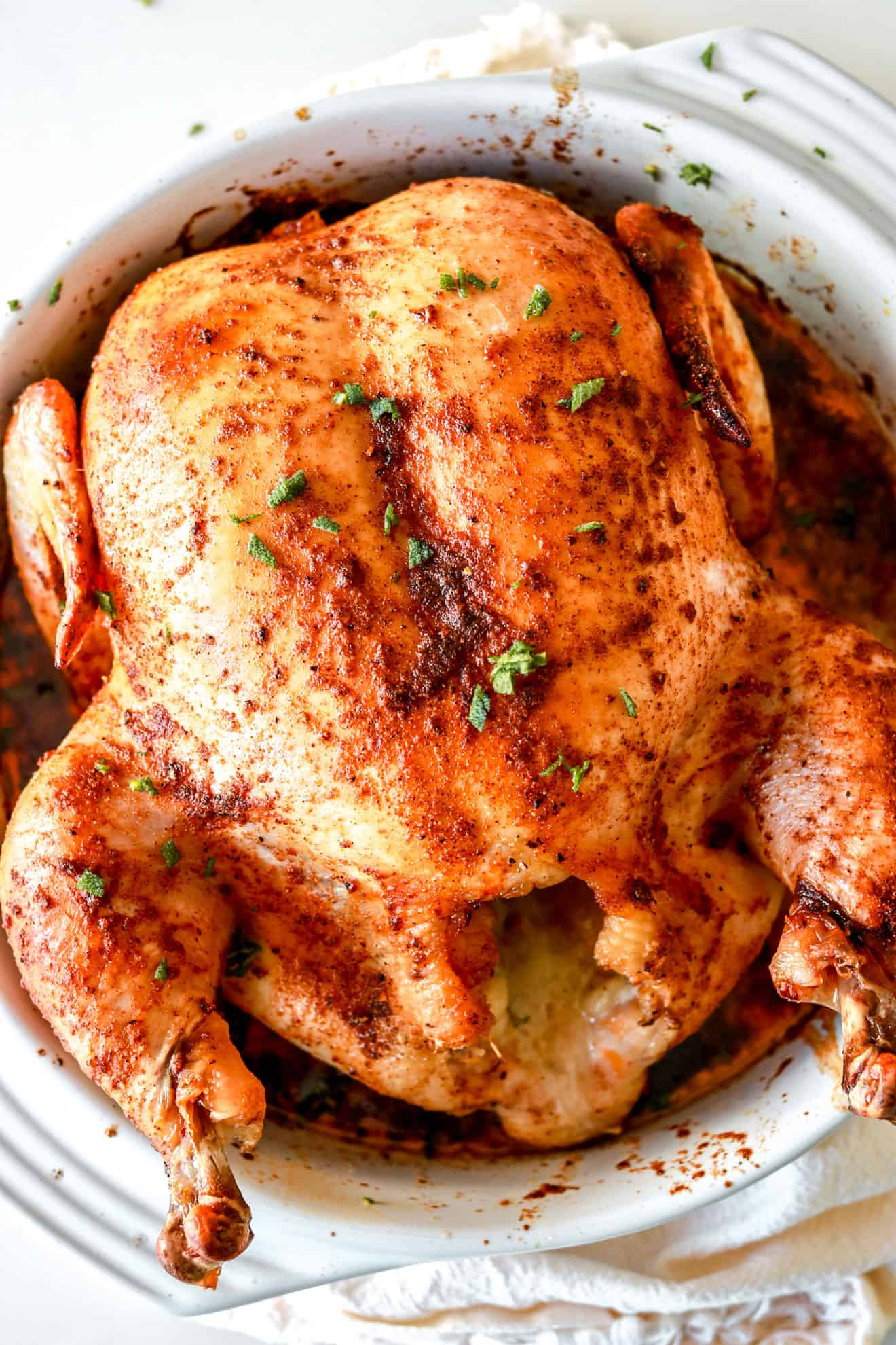 baking dish with roasted whole chicken
