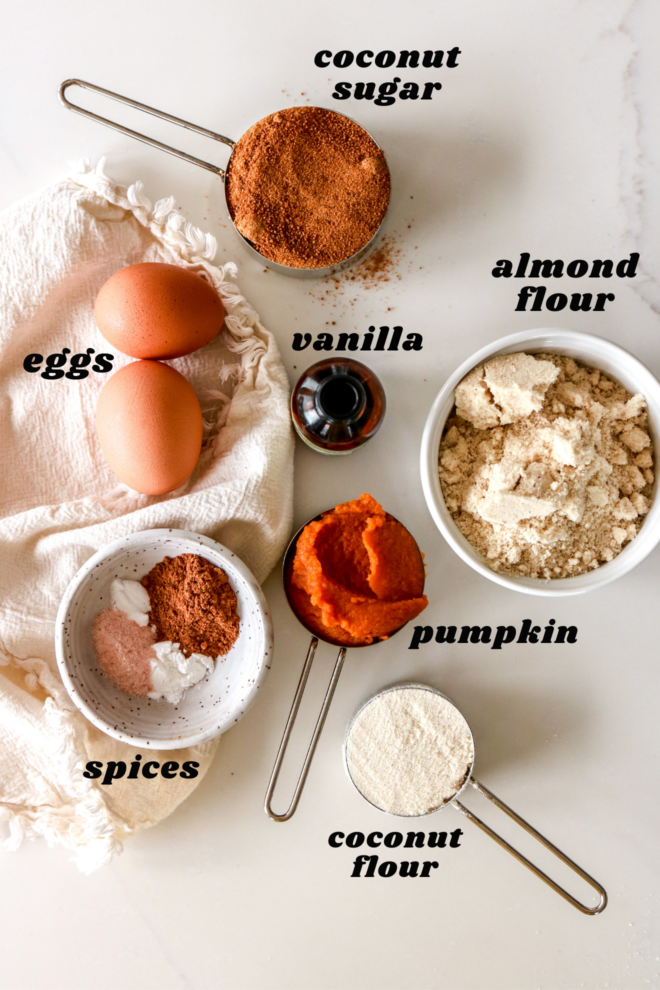 all the ingredients to make pumpkin whoopie pies labeled and on a white counter