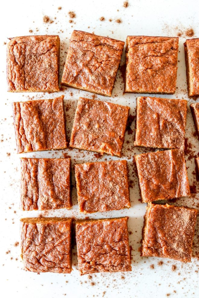 pumpkin banana cake bars on white counter cut in squares